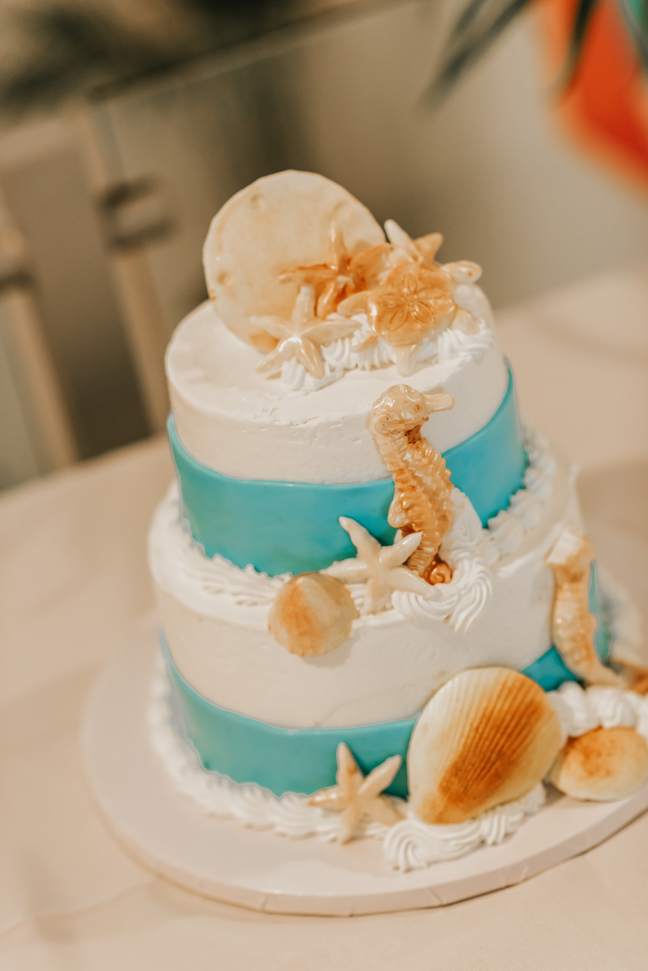 Elana and Marc's wedding cake was adorned with seashells and pineapple jam. Photo by Regina Rached.