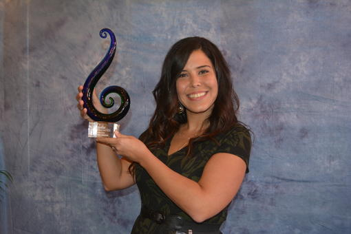 Amanda Arnold shows off her Sandies award for Rising Star.