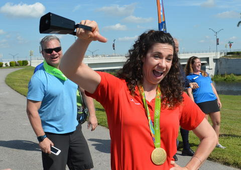 Olympic rowing gold medalist Amanda Polk, who performed in Rio with the winning United States women's eight team, signals the countdown to the World Championships with a cowbell.