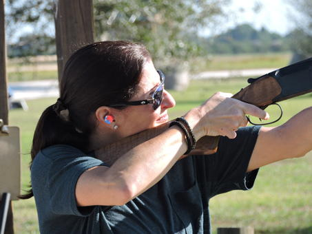 Palmetto'  s Sarah Mackie lines up a shot during the Sporting Clays Tournament Thursday to benefit Suncoast Charities for Children.