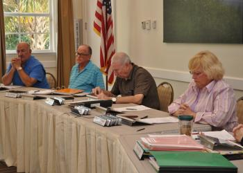 Members of the Inter-District Authority Board vote on their 2015-2016 budget.