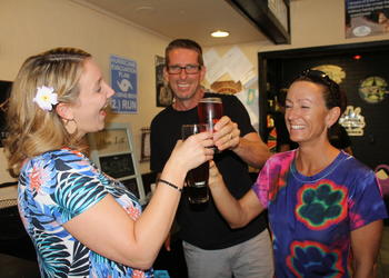 East County's Sierra Butler, Mike Gilkison and Stacey Gilkison cheers each other during the Cheers for Charity fundraiser.
