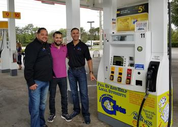 Nick and Moe's Shell Gas Station managers Jose Rodriguez and Mike Hass and owner Nick Salem show off one of their pumps aimed at helping R. Dan Nolan Middle School and Gilbert W. McNeal Elementary.