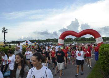 Hundreds charged through the Heart Walk heart to start the walk.