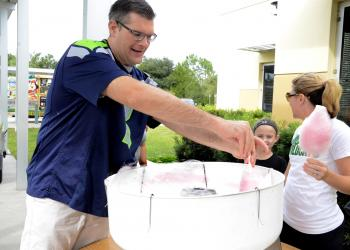 Doug Kovatch, a parent, volunteered to help Kristi Dyer, third-grade teacher, make the cotton candy. Kovatch said he used to work at a baseball stadium, so he was familiar with the proper cotton-candy-making technique.