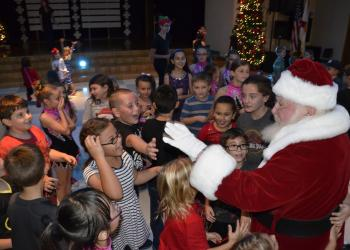 Santa greets Tara students.