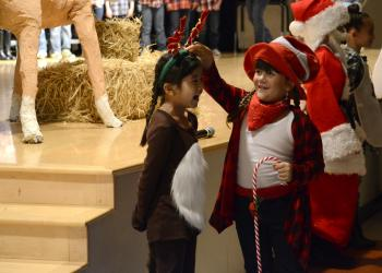 Amelia Villa Mosqueda and Chiara Diaz play Ralph the Reindeer and the Candy Cane Kid.