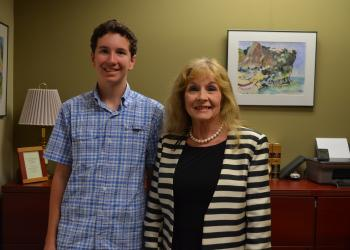 Country Club Shores resident Matthew Mason and Commissioner Lynn Larson