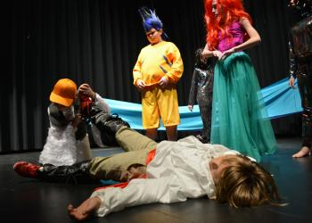 Scuttle (Ryan Newhams), Flounder (Dru Cappar) and Ariel (Alexia King) check to see if Prince Eric (Phineas Scanlon) is alive after he washes up on shore following a storm.