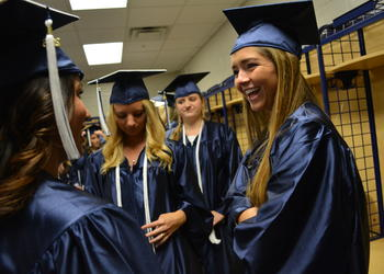 Jordan Bruder, right, laughs with friends before the ceremony begins.