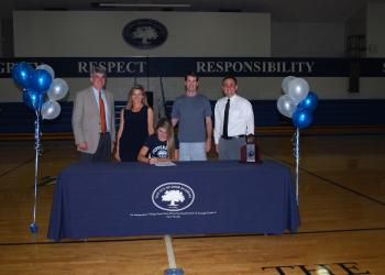 The Out-of-Door Academy's Joie Eckhard will swim for Pepperdine University in the fall after signing a national letter of intent in front of family and friends April 27. Courtesy photo