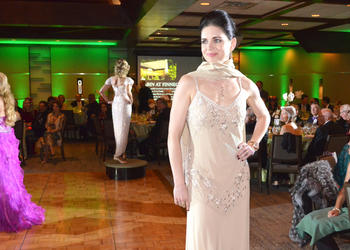 Olga Giminez models a gown from Designing Women Boutique.