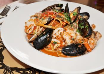 "Linguine fra diavolo, which means ""brother devil"" in Italian, refers to a spicy tomato sauce."