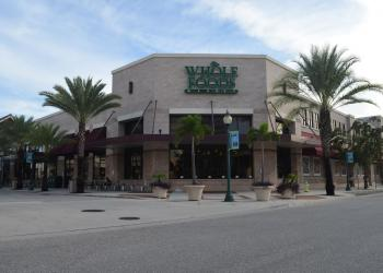 A Daytona Beach investment firm is betting on a bright future for downtown Sarasota with the purchase of Whole Foods Market Centre.