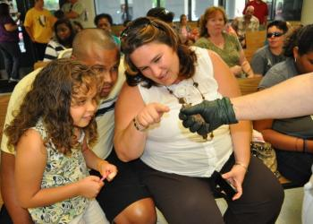 Hannaiz Nater, 6, checked out a bat with her parents Luis and Tanya.
