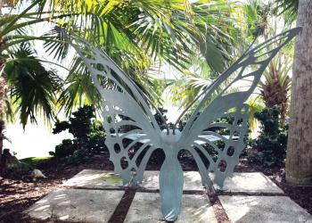 An ornate butterfly chair in the backyard is a special place for the owners to relax.