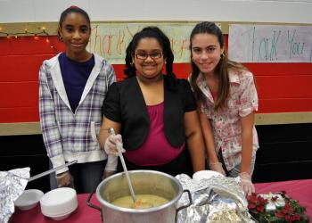 Precious Modupe, 14, Amelia Rupan, 13, and Abrielle Leeder, 12, served bowls of soup to guests.