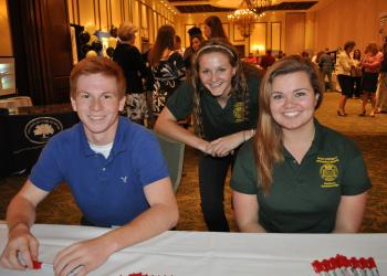 The Out-of-Door Academy's Josh Simon and St. Stephen's Episcopal School's Tori Biach and Savannah Glasgo welcomed guests.