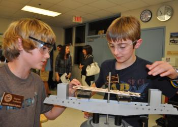 Technology students Stephen Husbands and Holden Scarbrough demonstrated how to make and test a balsa wood bridge.