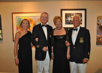 Marie and Incoming Commodore Bob Hunter and Carlene and outgoing Commodore Bob Baime