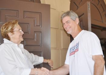 Rummage Sale Chairwoman Mary Elizabeth Carey welcomed Steve Bigelow, who was first in line at last year's rummage sale at St. Mary. File photo.