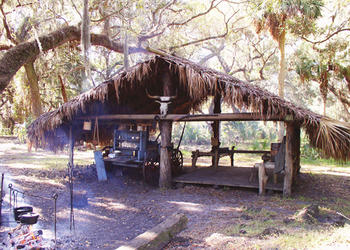 "A chickee hut at Kissimmee State Park is the recreation of an 1876 ""cow camp"" structure. Courtesy of Florida State Parks."