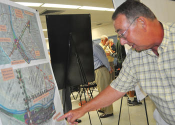 Art Tankersley checks out sketches of concepts for Longboat Key's north end.