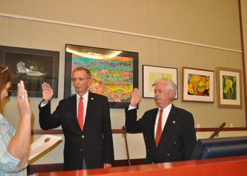 Town Clerk Trish Granger administers oaths of office to Vice Mayor David Brenner and Mayor Jim Brown.