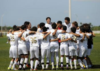 The Real Madrid Castilla U16 team pumps itself up before the start of its match versus IMG Soccer Academy.
