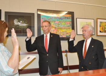 Town Clerk Trish Granger administers oaths of office Tuesday night to Vice Mayor David Brenner and Mayor Jim Brown. Photo by Dora Walters.