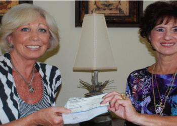 Susan Ford, President of Sarasota British Club, presents check to Sharon Leber, founder of Hope in a Backpack.