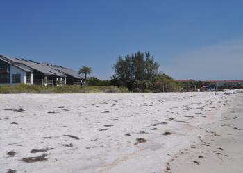 Town officials estimate that 30 to 50 feet of dry beach remain between the Gulf and 360 North condominiums.