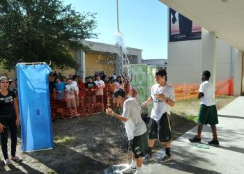 Students were challenged to bathe with only five gallons of water, using their homemade showerheads.