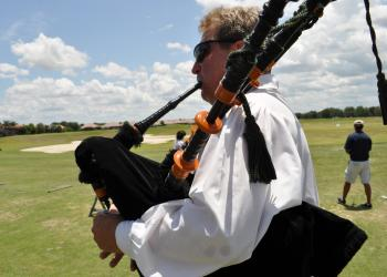 Gary Reinstrom, of the Jacobites Pipe & Drum Band, kept the mood lively as the golfers began the tournament.