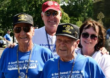 World War II veterans Tony Lingrosso and ElRoy York traveled with their guardians, Marins Richard and Avone Thielen. Photo by Keith Millard, of Keith A. Millard Photography.