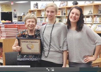 Sonia Pressman Fuentes presents Caitlin Gish and Kaley deLeon with copies of her memoirs. Courtesy photo.