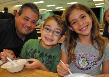 Dillon Forbes, center, enjoyed ice cream with his dad, Lee, and friend Gianna Caso, right.