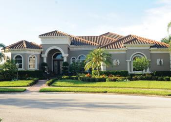 This Country Club Village at Lakewood Ranch home, which has four bedrooms, four-and-a-half baths, a pool and 5,437 square feet of living, sold for $1,637,500. Photo by Jen Blanco.