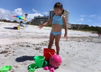 Matilda Diconstanzo, 3, has fun Monday, Oct. 1, playing by the water and collecting seashells at Lido Beach.