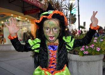 Giordana Spagnolo, 6, does her scariest witch impression Wednesday, Oct. 31, on St. Armands Circle. Spagnolo lost her first tooth that day which added to her scary witch persona.
