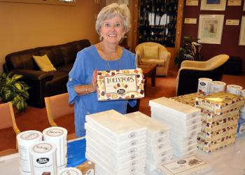 Bonney Libman holds up Gourmet Lollypops from See's Candy.