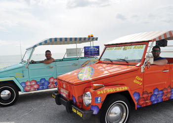 Tony and Chris Aveni, of Surf Side Free Ride, take passengers around Siesta Key for free with their 1973 Volkswagen Things.