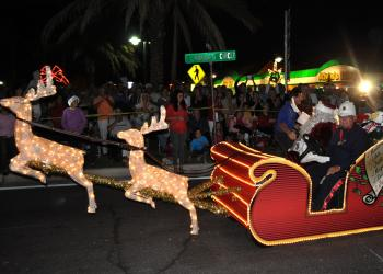 Santa waves to the crowd from his sleigh Friday, Dec. 7, during the Holiday Night of Lights on St. Armands Circle.