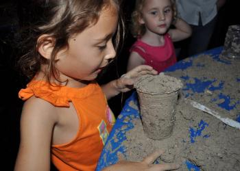 Lily Schlosberg, 5, learned how to make a menorah out of sand.