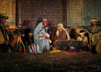 Mary and Joseph and the baby Jesus, portrayed by Whitney Kitchens, Carlos Motta and Hudson Drake.