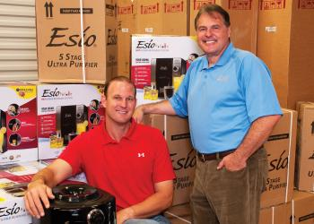 Matt Drews, sitting, and Chuck Vollmer run the Sarasota-based franchise for Esio Beverage System. The company offers what it calls the first hot-and-cold, ready-to-drink beverage dispenser on the market. Photo by Lori Sax.