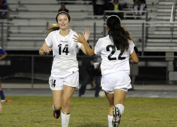 Braden River's Carly Provan is congratulated by one of her teammates after scoring her second goal in the final seconds of the match.