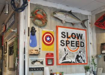 New Pass Grill looks like the cleanest bait shop you'll ever see. Fishing lures, Old Florida prints, oars, nets and flippers adorn the walls.