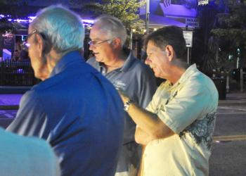 Siesta Key Chamber of Commerce Chairman Mark Smith in June evaluates Siesta Village crosswalk lighting options.