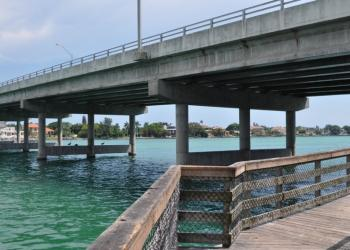 The Florida Department of Transportation is in the process of painting New Pass Bridge.
